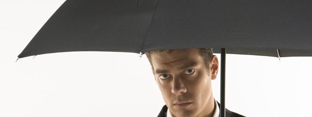 man under umbrella